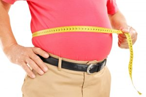 man-measuring-his-stomach
